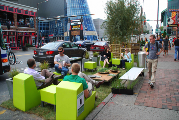 Caption: A parking space in Nashville is transformed into a small but, vibrant, parklet. Source: my.parkingday.org