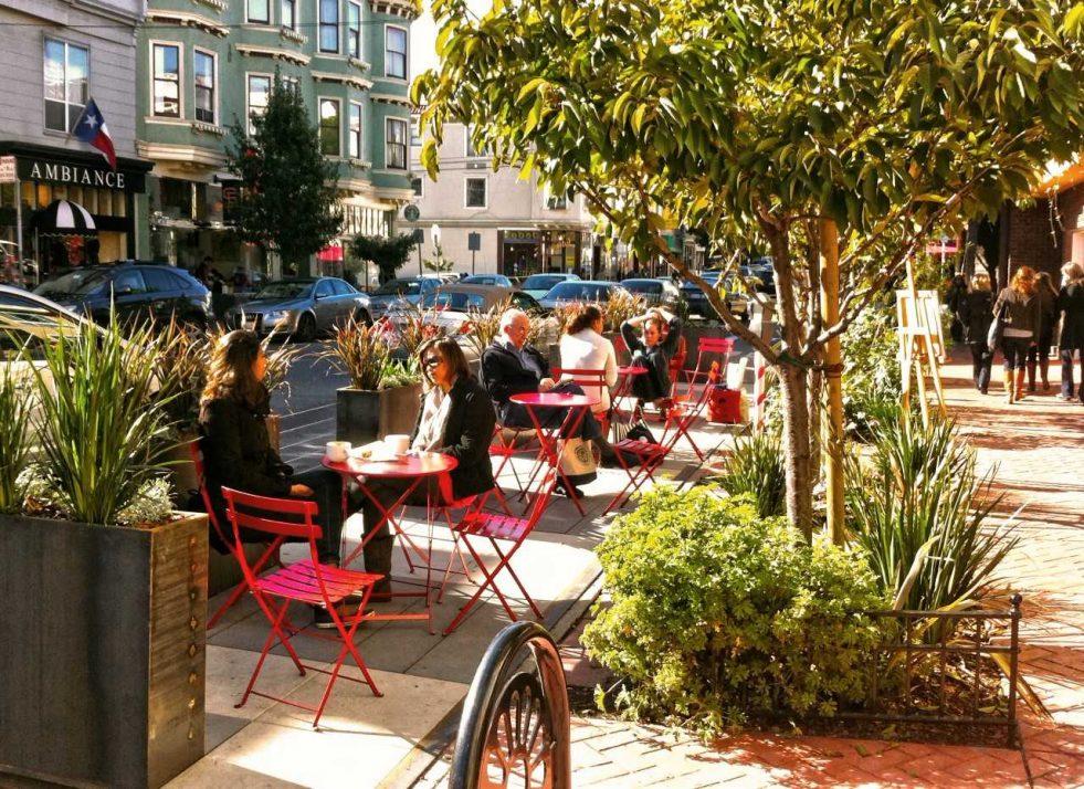 "Wooden ""parklets"" widen a sidewalk in San Francisco."