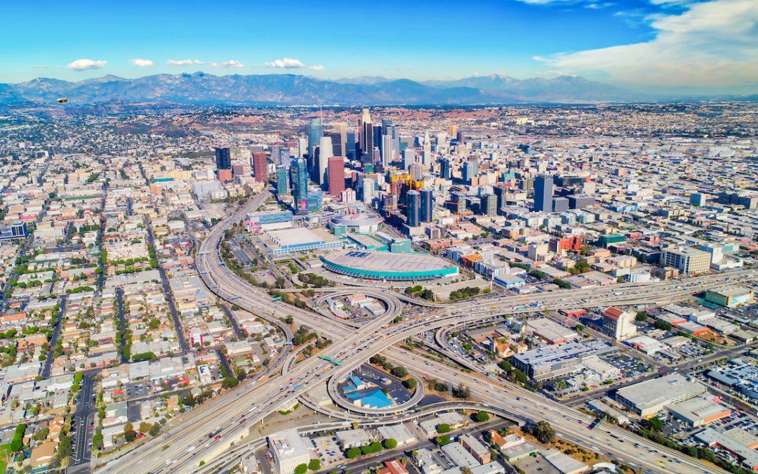 Balancing Data Privacy and Data Sharing Between TNCs and Cities